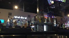 Liquor and beer selection at bar - stock footage