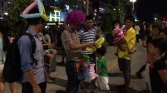 ballon seller in night Saigon city - stock footage