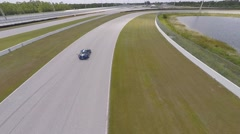 Porsche fly by, aerial view on race track Stock Footage