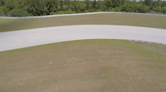 Porsche on race track, aerial view Stock Footage