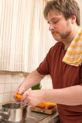 overweight man is cooking healthy vegetables - stock photo