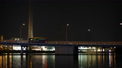 Traffic Crossing a Busy Bridge at Night under the Macau Tower Stock Footage