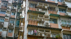 Old, Rust Streaked Facade of an Apartment Building in Asia Stock Footage
