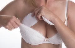 Woman boosting her bra size with soma added padding - stock photo