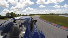 Porsche on race track, Go Pro view from back of the car - stock footage
