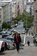 Woman Carrying Shopping Bags Climbs Steep Steps In Nob Hill - stock photo