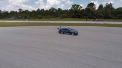Porsche on race track, aerial view tracking shot Stock Footage