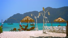 Tourists Resting in the Shade on Phi-Phi Island in Thailand Stock Footage