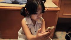 Asian girls playing a game on smart phone Arkistovideo