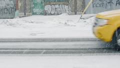 Taxi cab on street during snowstorm. New York City. Stock Footage