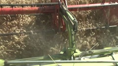 View of the header from the combine cabin - stock footage