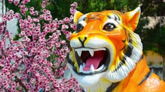 Detailed Tiger Statue outside Buddhist Temple in Southeast Asia Stock Footage