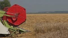 Combine header harvesting wheat - stock footage
