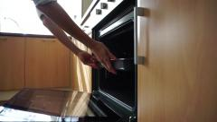 Baking tray being placed in an oven Stock Footage