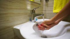 Girl washing and wiping her hands Stock Footage