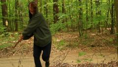 Crazy axe woman brandishing an axe in the air and passing camera Stock Footage