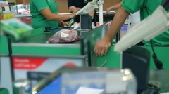 Customers at Checkout Lane Paying for Food in Supermarket Stock Footage