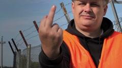 Worker showing obscene gesture Stock Footage