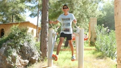 4k, man  playing sports on the training apparatus outdoors 2 Stock Footage