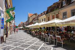 Outdoor cafe at Republic street, near Council Square, Brasov Stock Photos