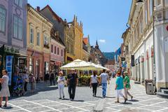 Outdoor cafe at Republic street, near Council Square, Brasov - stock photo