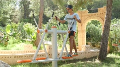 Stock Video Footage of 4k, man playing sports on the training apparatus outdoors 2