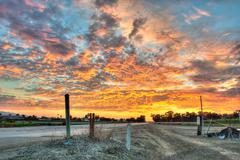Vibrant sky over country highway - stock photo