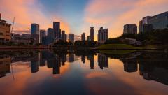 Time lapse:Beautiful golden sunrise view of Kuala Lumpur buildings reflection Stock Footage