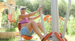 Stock Video Footage of 4k, woman playing sports on the training apparatus outdoors 1