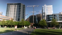 Dallas downtown park timelapse w/ pedestrians & moving construction cranes Stock Footage