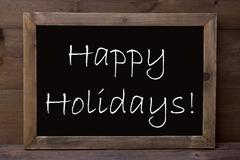 Chalkboard With Happy Holidays Stock Photos