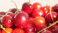 Lot of sour cherries on white background slow tilting food natural  4K 2160p Stock Footage