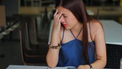 Unhappy Bored thai adult beautiful girl read message on Smartphone. Stock Footage