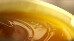 Mixing of golden honey Stock Footage