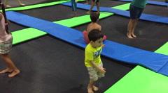 Kid jump on the trampoline Stock Footage