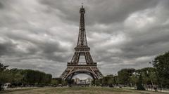 Stock Video Footage of Eiffel Tower & Champ de Mars, Cloudy Sky, Paris, Time Lapse