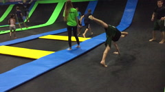 Kids doing flips on the trampoline Stock Footage