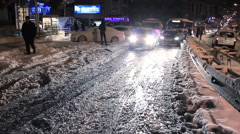 Many cars stuck in snow on the city streets Stock Footage