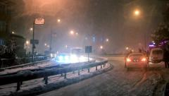 Abandoned car stuck in the snow during a blizzard at Maltepe Stock Footage