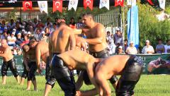The beaten wrestler is never satisfied with wrestling (Turkish Proverb) - stock footage