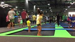 Kids jump on trumpolines Stock Footage