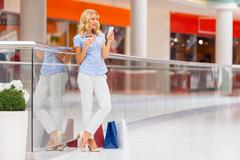Beautiful girl shopping in a mall - stock photo