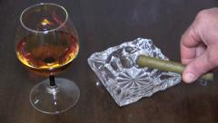 Stock Video Footage of Cigar in ashtray next to glass of brandy