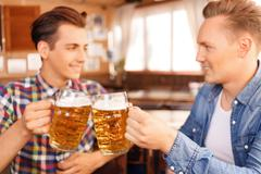 Contented friend drinking beer - stock photo