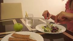Beautiful girl in a pink dress having her healthy meal - stock footage