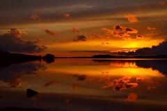 Fiery sunset. Lake Pongola, Northern Karelia, Russia Stock Photos