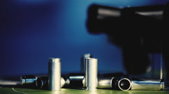Shells and pistols on a blue background close up Stock Footage