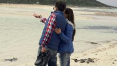 Young couple hugging and admire beach view, slow motion shot at 240fps Stock Footage