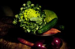 Footed plate with vegetables Stock Photos