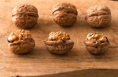 walnuts on a cutting board - stock photo